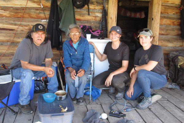 Woodland Caribou Traditional Knowledge gathering north of Pelican Narrows, Saskatchewan. Left to Right- Ray Highway, Elder Annie Sewap, Sarah Schmid and Eden Friesen.